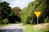 Yield sign near crossroad — Stock Photo