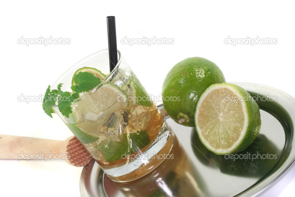 Mojito on a platter with fresh lime and lemon balm — Stock Photo #2751110