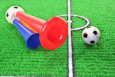 Soccer horn with football — Stockfoto