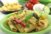 Tortiglione with fiery chili and zucchini — Stock Photo