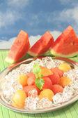Melon on ice — Stock Photo