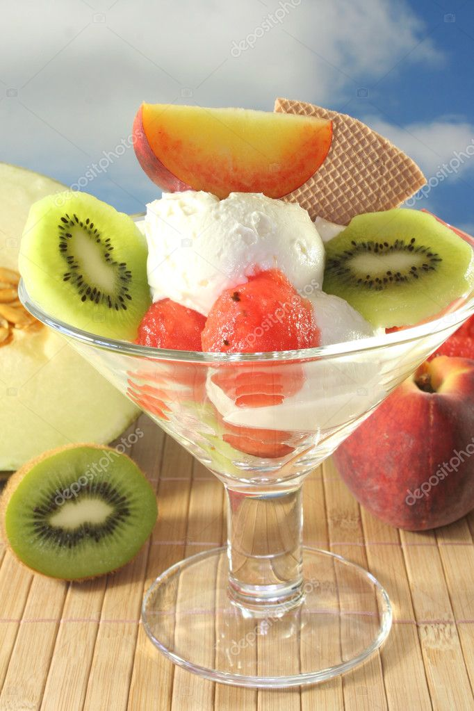 Fruit sundae with fresh kiwi, peach and melon  Stock Photo #3530251