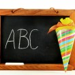 Stock Photo: Blackboard with school cone