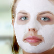 Young female face with clay mask — Stock Photo