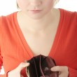 Young woman shows empty wallet — Stock Photo