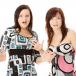 Stock Photo: Two young womans surprised
