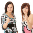 Two young womans pointing — Stockfoto