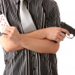 Stock Photo: Young poker player with gun