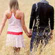 Couple in grain field — Stock Photo