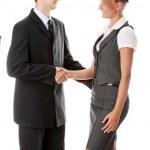 Young business couple handshaking — Stock Photo