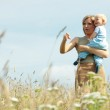 Woman with baby on her shoulders in a country — Stock Photo