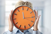 Woman holding big alarm clock — Stockfoto