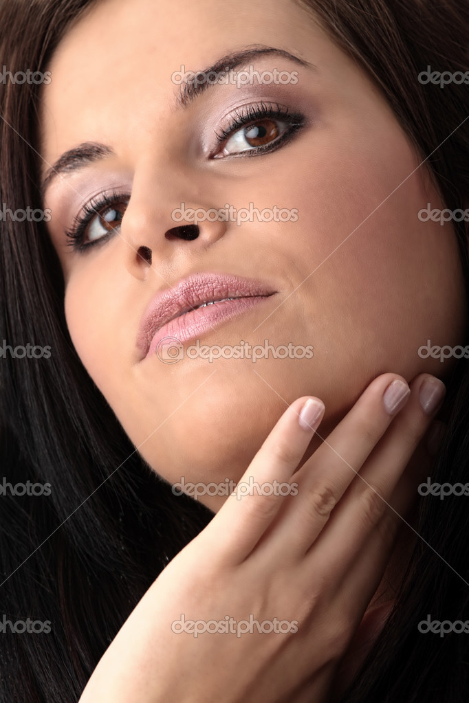Closeup, studio shot of a young, beautiful, brunette woman — Stock Photo #3135383