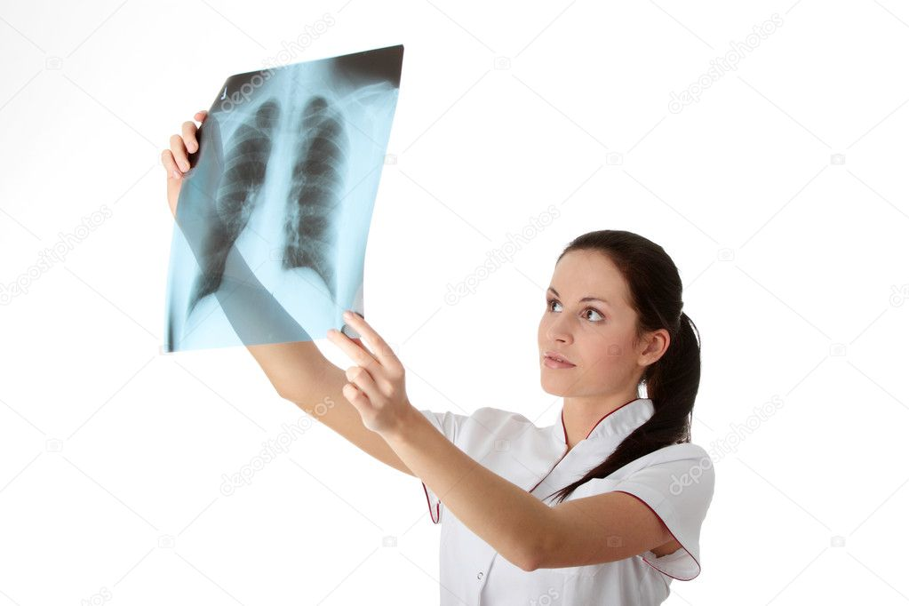 Female doctor looking at an x-ray   Stock Photo #3135866