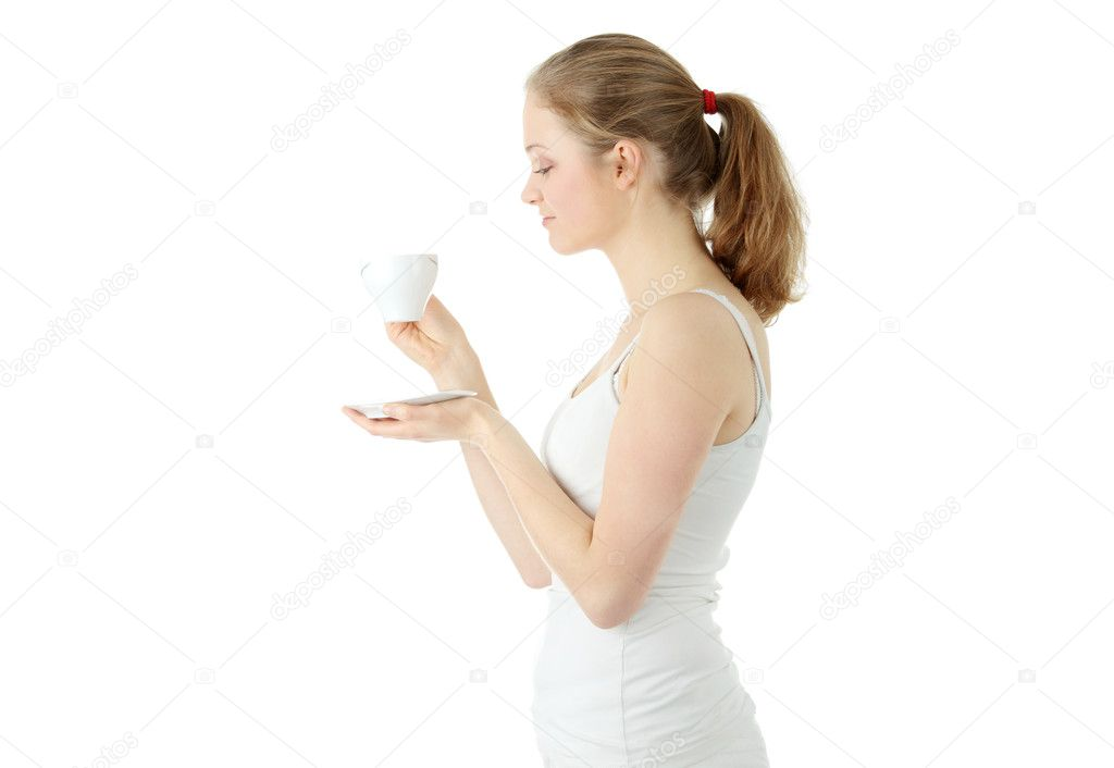 Young attractive blond woman drinking coffee, isolated on white background — Stock Photo #3137879