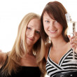 Two casual young women enjoying champagne — Stock Photo #3141362