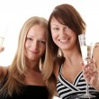 Two casual young women enjoying champagne — Stock Photo