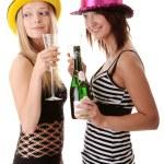 Two casual young women enjoying champagne — Stock Photo