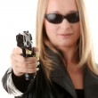 Portrait of the blonde with gun — Stock Photo #3141475