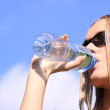 Girl drinking water — Stock Photo