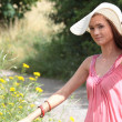 A beautiful girl in the country — Stock Photo