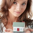 Young woman holding euros bills and house model — Stock Photo #3141730