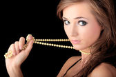 Woman with a pearl necklace — Stock Photo