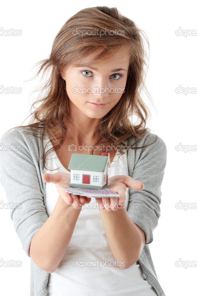 Beautiful young woman holding euros bills and house model over white - real estate loan concept — Stock Photo #3141769