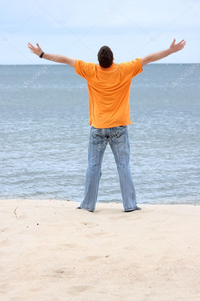 Happy young man on the beach — Stock Photo #3179463