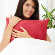 Young woman with red pillow — Stock Photo #3738048