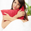 Young woman with red pillow — Stock Photo #3738054