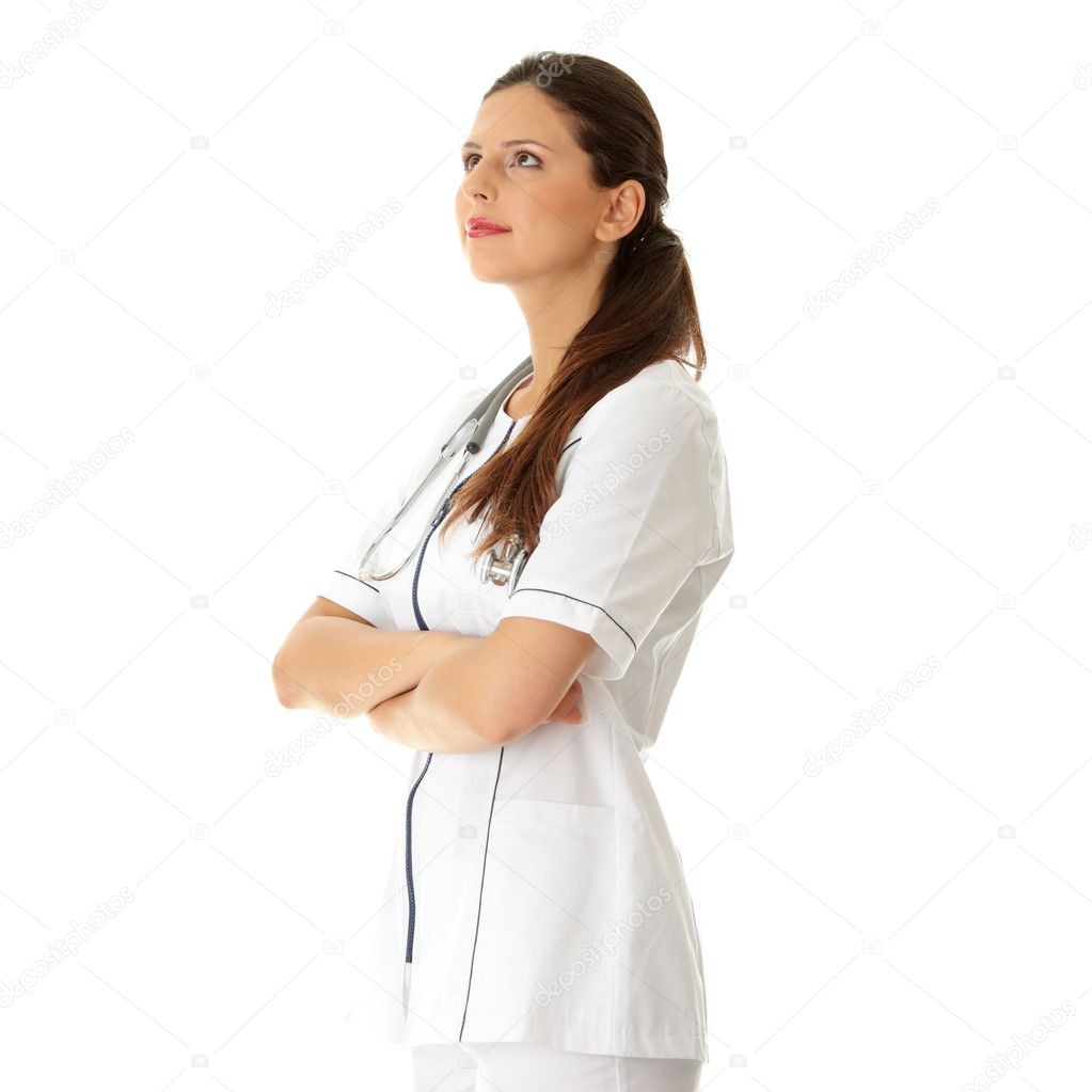 Female doctor looking upper left corner — Stock Photo #3738727