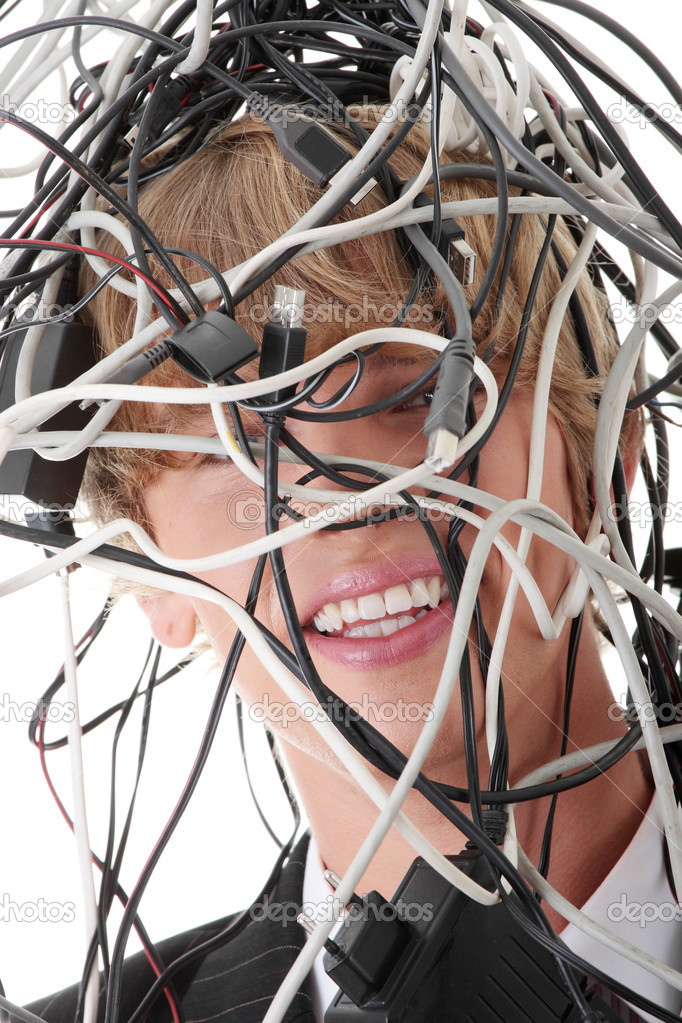 Businessman wrapped in computer cables — Stock Photo #3811398