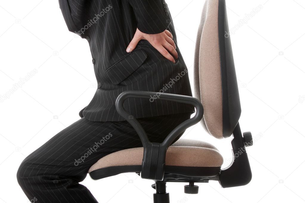 Businessman holding his hand to his aching back  — Stock Photo #3811432