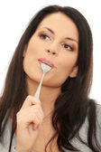Young smiling woman with spoon — Stock Photo