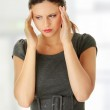 Young business woman with headache — Stock Photo #3862561