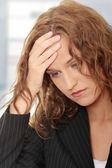 Mulher de negócios com dor de cabeça — Foto Stock