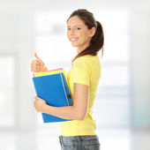 Student girl with thumb up — Stock Photo