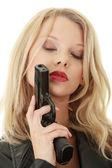 Sexy blond woman with handgun — Stock Photo