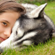 Young girl and her friend, siberian husky — Stock Photo