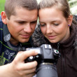 Stock Photo: Photographer shows camera shot girl