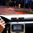 Night riding in street traffic with gps map — Stock Photo