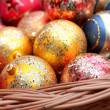 Stock Photo: Christmas baubles in wicker basket