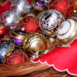 Christmas baubles in wicker basket — Stock Photo