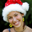 Portrait of beautiful Christmas girl in a Santa Claus hat — Stock Photo