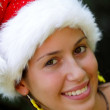 Portrait of beautiful Christmas girl in a Santa Claus hat — Stock Photo #3739350