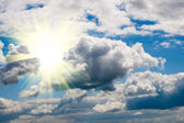 Bright sun and white clouds — Stock Photo