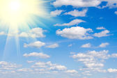 Bright sun and white clouds, heavenly landscape — Stock Photo
