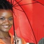 Black Woman Holding an Umbrella — Stock Photo #2895618