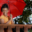 Stock Photo: Black Woman Holding an Umbrella
